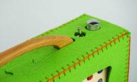 Detail view of a green hörbert felt bag